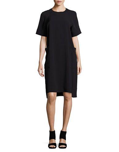 """<ul><li>Eye-catching shift dress designed for a chic look</li><li>Ribbed crew neck</li><li>Raglan short sleeves with ribbed cuffs</li><li>Waist patch pockets</li><li>High-low hem</li><li>About 40"""" from shoulder to hem</li><li>Triacetate/viscose/rayon/nylon</li><li>Dry clean</li><li>Imported</li></ul>"""