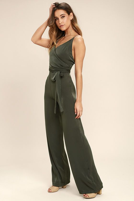 62e95a91371 You ll always leave a lasting impression in the Got You On My Mind Olive  Green Jumpsuit! Luxurious woven fabric falls from adjustable spaghetti  straps into ...