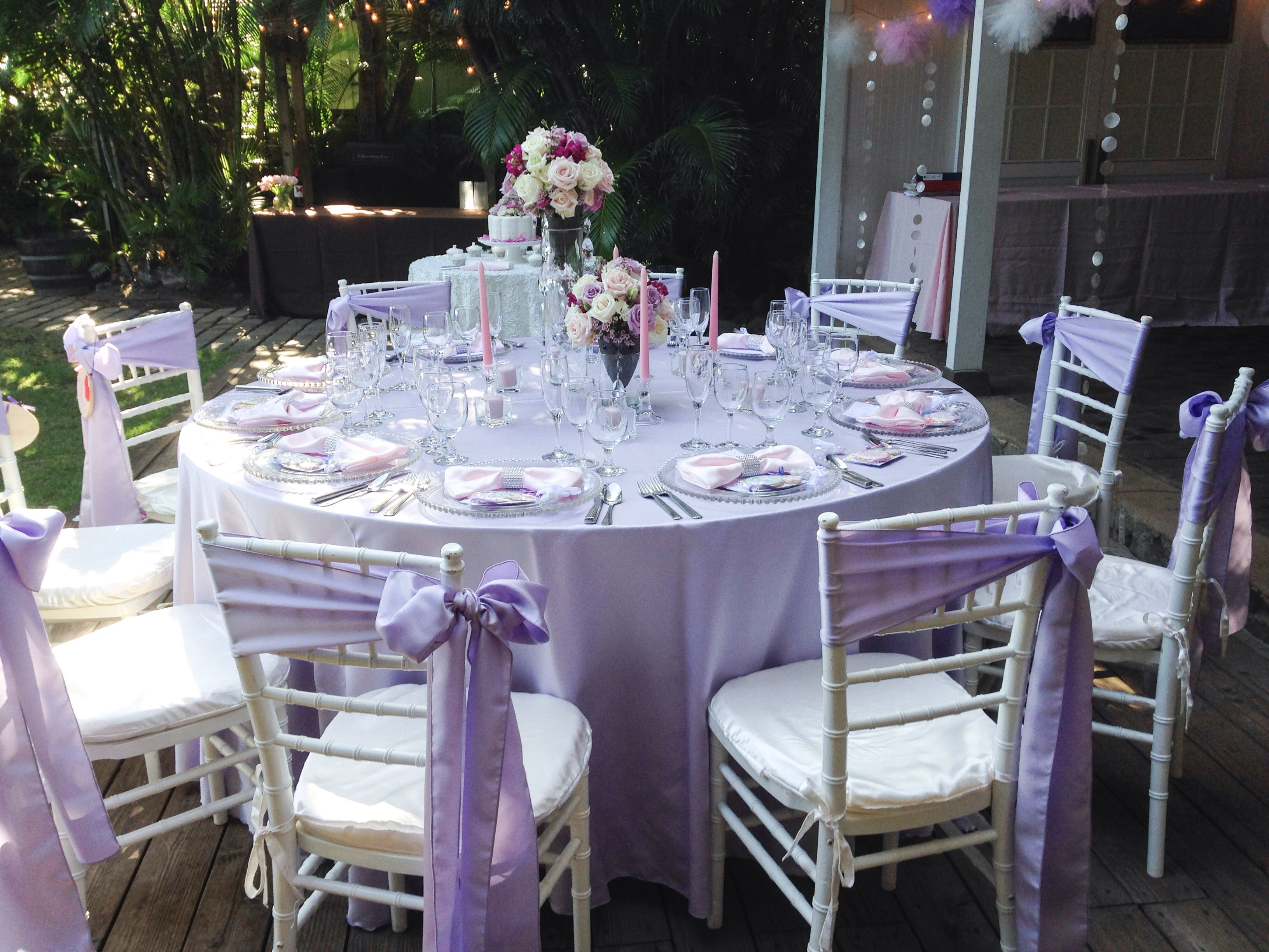 lilac tablecloths + silver chivari chairs +  all white centerpieces