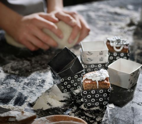 Several small square baking cups with different patterns.