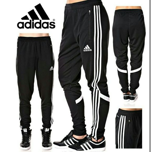 f9e9ddf6c22294 Listing Adidas pants Great pair of track pants. Features 3 stripes and neon  yellow stitching Two pockets in the front and ankle zippers Drawstring in  the ...