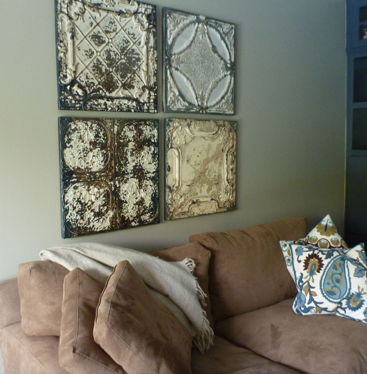 Salvaged tin ceiling tiles as focal point httptheopensuitcase antique tin ceiling tile mirror what do you need to know about acoustic ceiling tiles as far as the reason why theyre pop dailygadgetfo Images