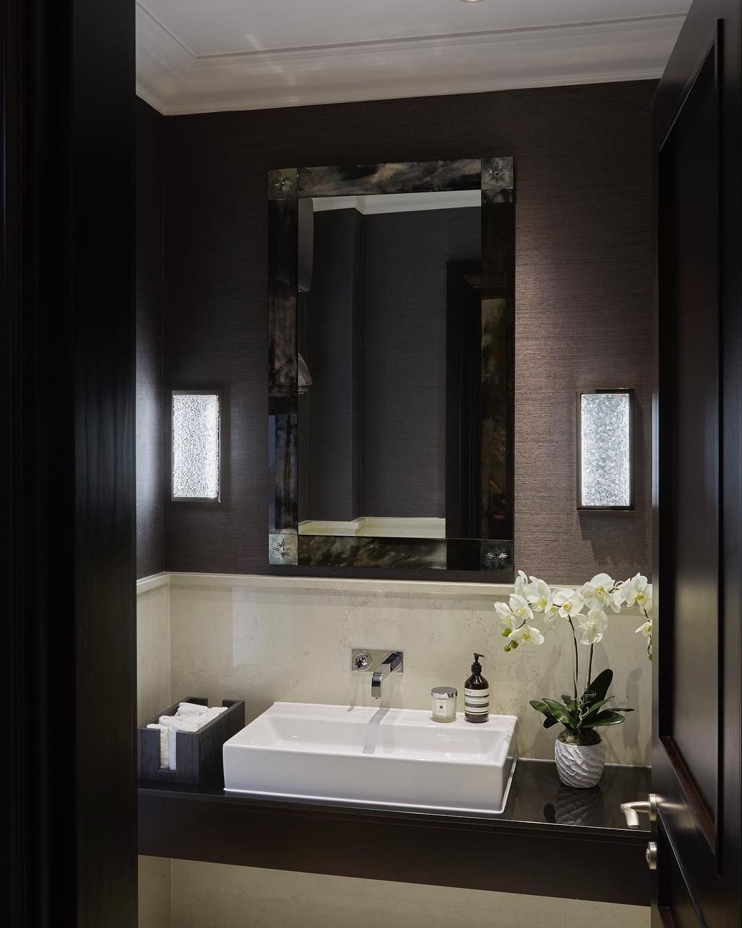 Guest bathroom with grasscloth wall covering and bespoke