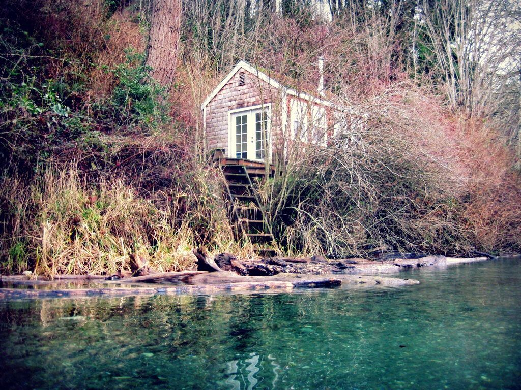 Tiny beach cottage along the Colvos Passage near Fragaria, Washington. Photo by Joel Lee from his sea kayak.