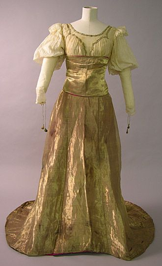 This evening dress made in about 1910 was worn by Maud Messel. The dress is in an aesthetic, medieval inspired style and might have been worn as fancy dress.