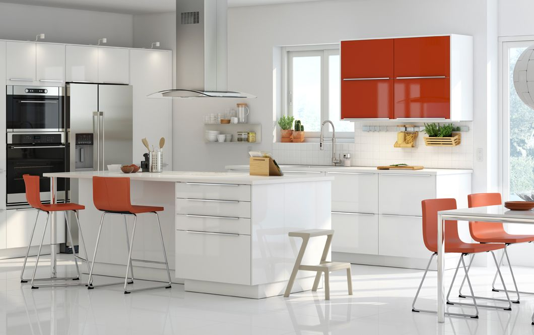 A small kitchen with orange high gloss wall cabinets and for White high gloss kitchen wall units