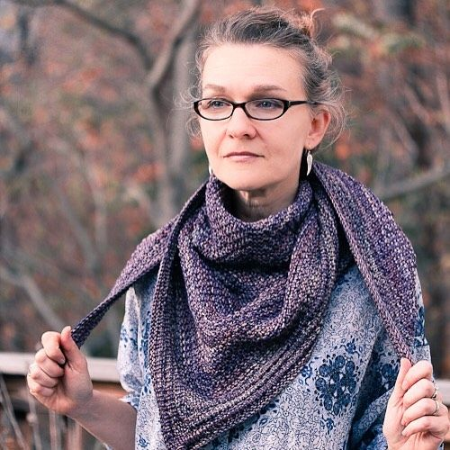 Thisis a perfect example of my working day style; casual shirt, hair pulled back, and hanging out on my deck; the Courser shawl in Malabrigo yarn.