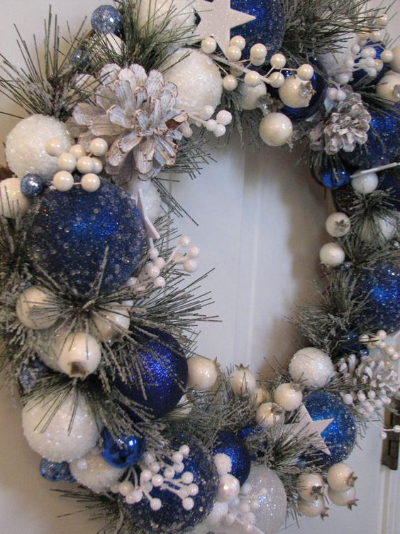 This Royal Blue And White Wreath Seems To Be Frozen And Snowy Christmas Wreaths White Christmas Wreath Blue Christmas Tree