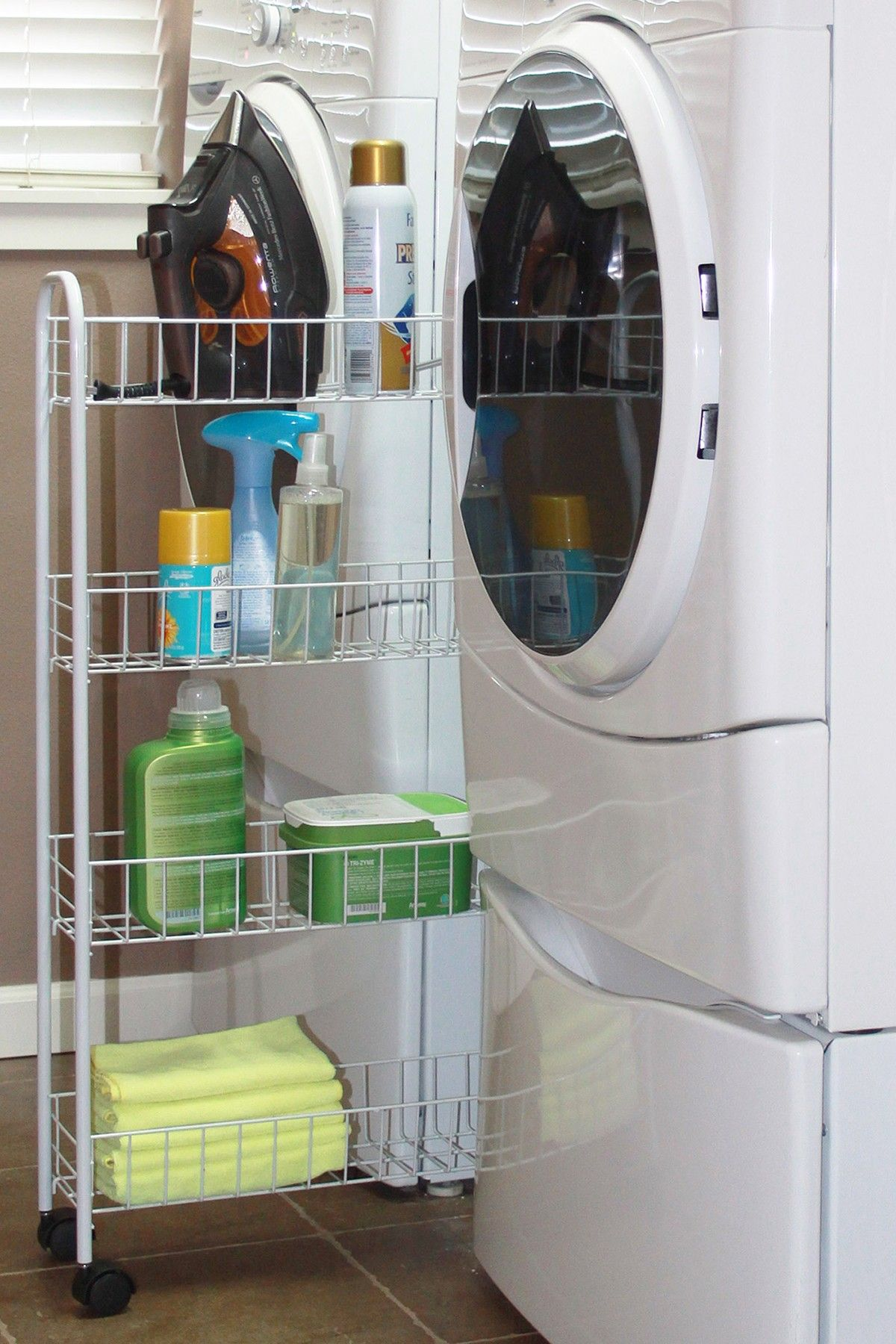 store laundry supplies b/t the washer & dryer with a storage rack