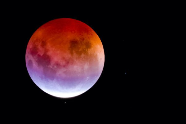 This month's full strawberry moon is also an eclipse—here's what that means for your sign