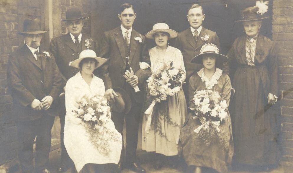Vintage wedding group shot. Sitters unknown.