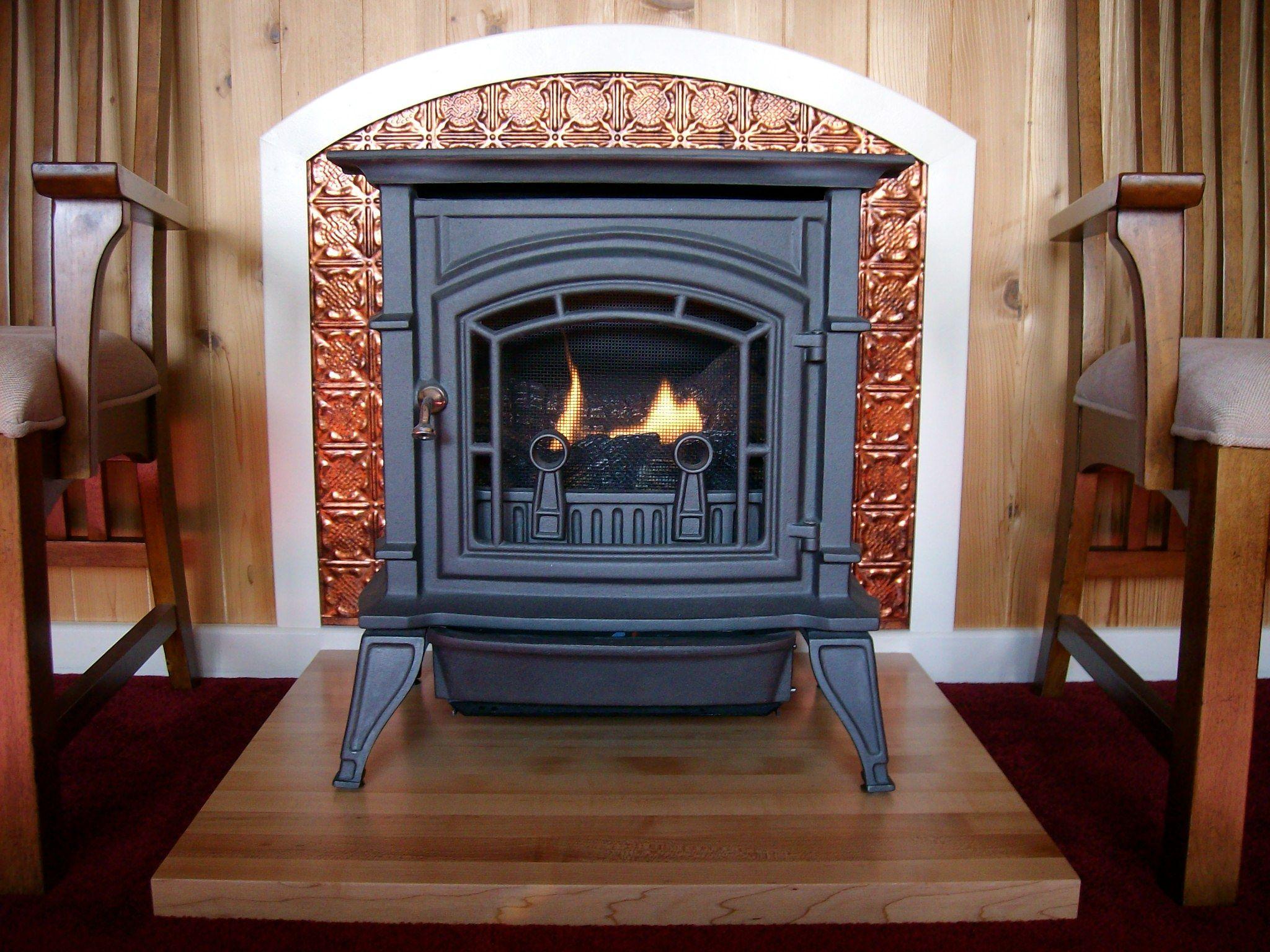 wooden fireplace base fasade backsplash in moonstone copper