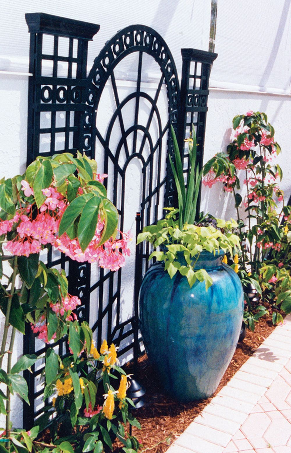 The container garden and trellis mix beautifully together in this ...
