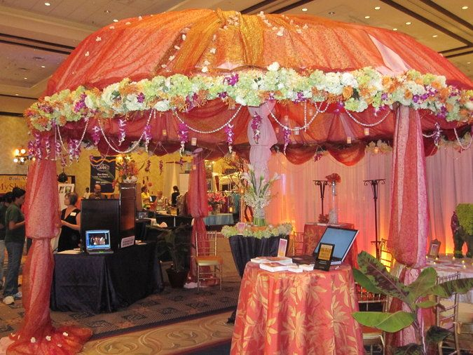 Covered booth example. Wouldn't this be a beautiful cocktail welcome at your destination wedding? We'll  make it happen! destinationweddings.travel