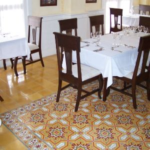 Restaurants cement tile rug adds depth interest cement room and avente tile project cement tile rug for a dining room ppazfo