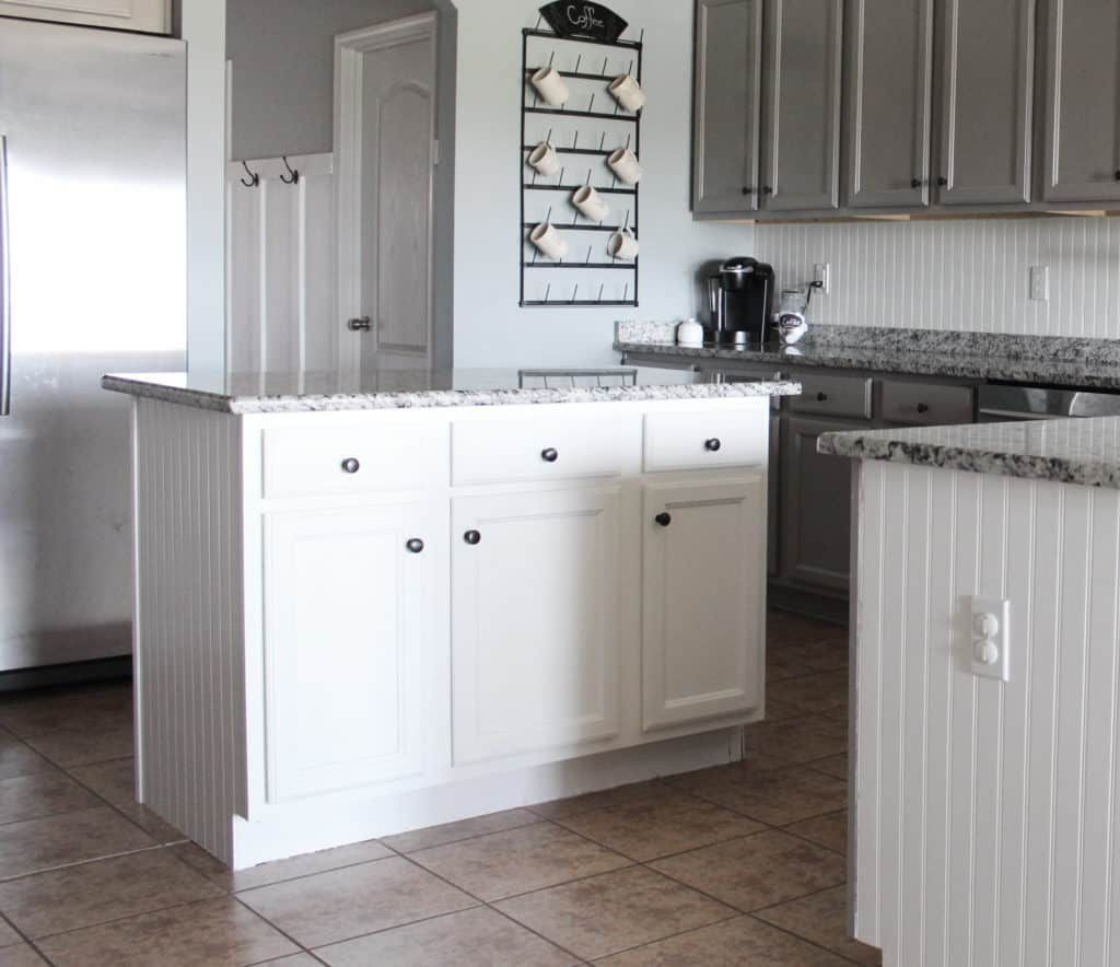 A Year In Review Of How I Painted My Laminate Cabinets With Two Methods In 2020 Laminate Cabinets Laminate Kitchen Cabinets Painting Laminate Kitchen Cabinets