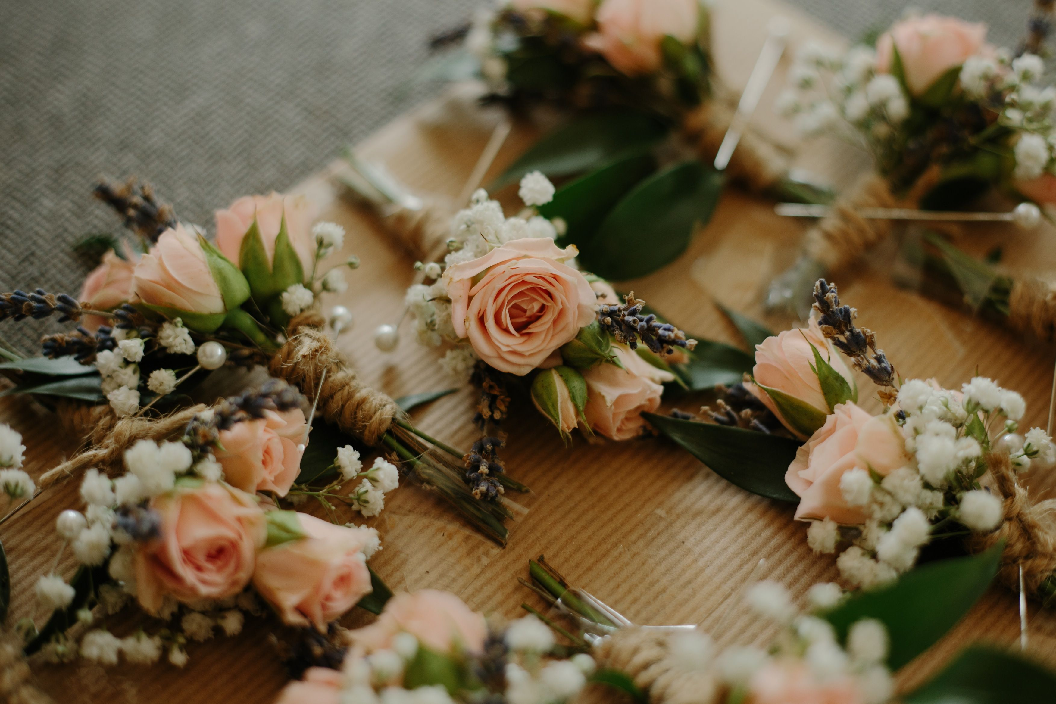 Rose buttonholes for the groom groomsmen wedding goals