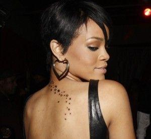 Rihanna S Stars Tattoo Down Her Neck Back Star Tattoos Rihanna Star Tattoo Rihanna Neck Tattoo