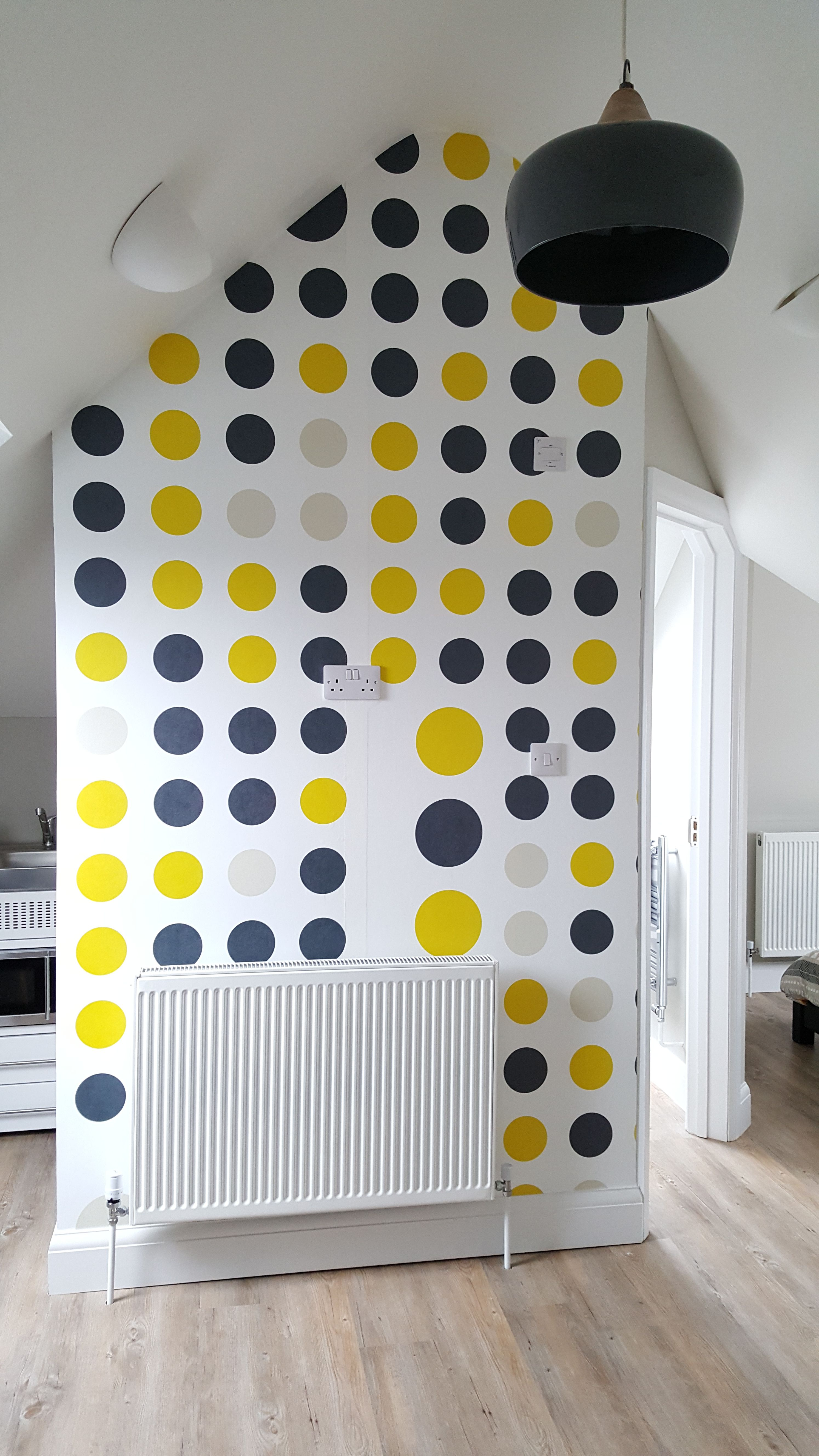 Loft conversion with bespoke dots feature wall