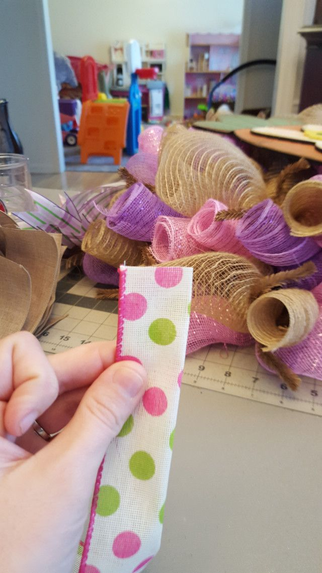 Photo of Adding ribbon to a wreath