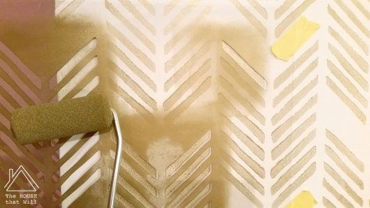 Stenciling an accent wall in a bedroom using the Drifting Arrows ...