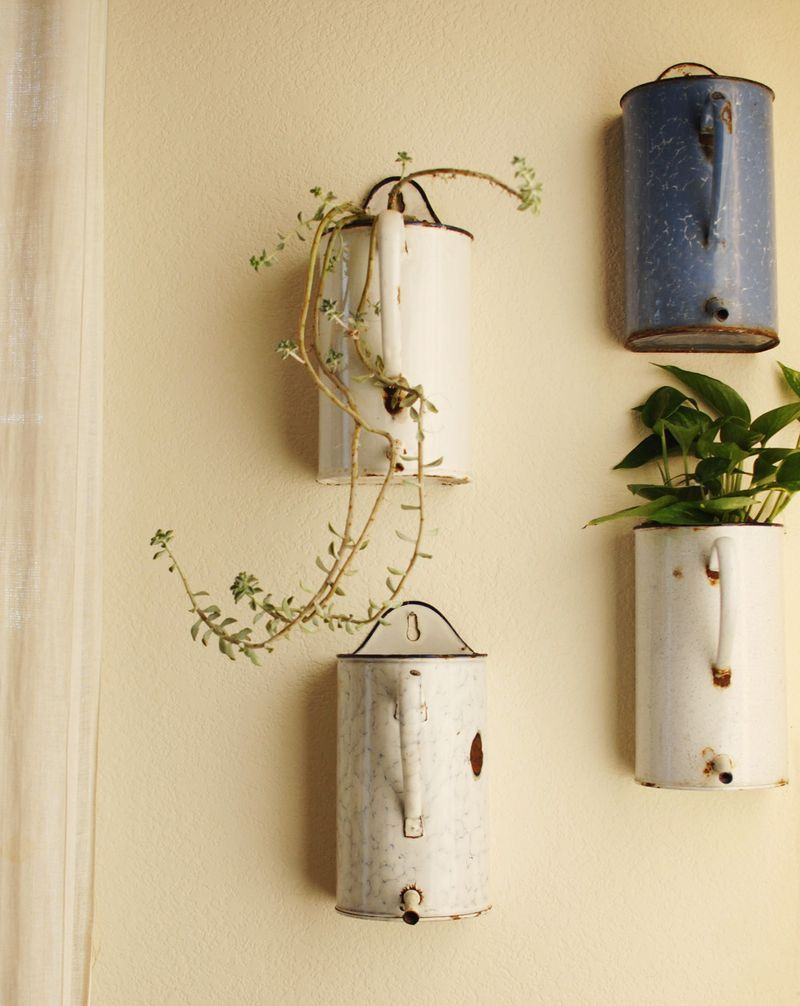 I like these plant containers on the walls. Saves the floor from ...