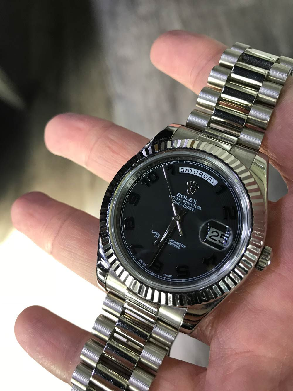38d2be94a The Rolex President. 41mm, 18K white gold case and fluted bezel, black  concentric circle dial, black Arabic numerals, and President bracelet.
