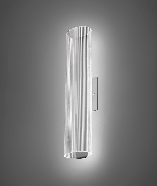 Clara LED luminaire is available in linear-suspended and wall-sconce models. The fixture has a hollow, oval-lensed body in which LEDs shine through and around, providing direct and indirect illumination. The lensed body is available in clear and semi-frosted. Pinstripe-like lines are embedded in the lens. The luminaire is available in 3,000 and 4,000 K. The ...