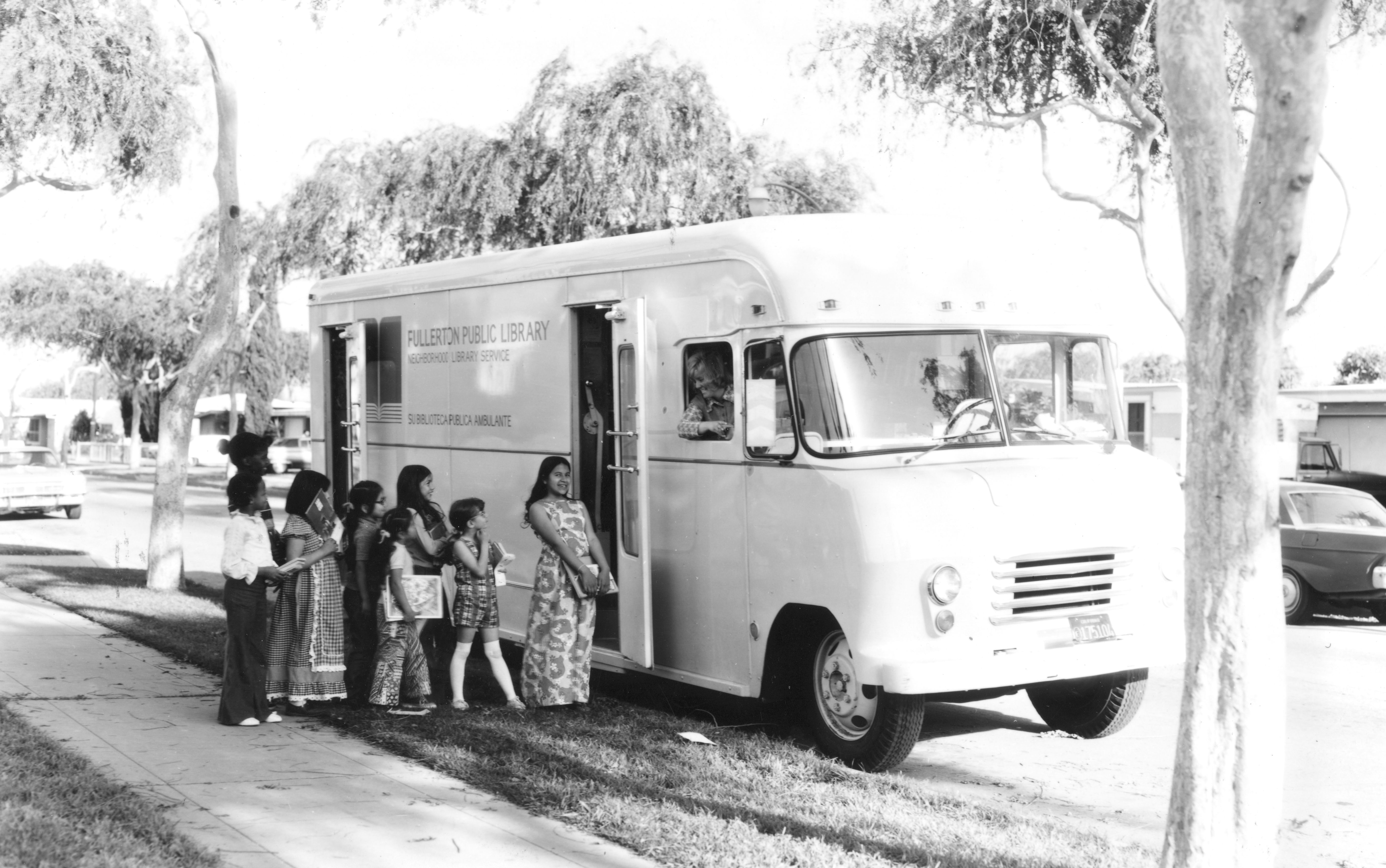 In 1957, Fullerton started the first bookmobile service in Orange County.  Bookmobile librarian Barbara Weber, who connected readers with books for over 35 years, is shown here in 1973 at the Valencia and Lemon Avenues stop in Fullerton's second bookmobile.