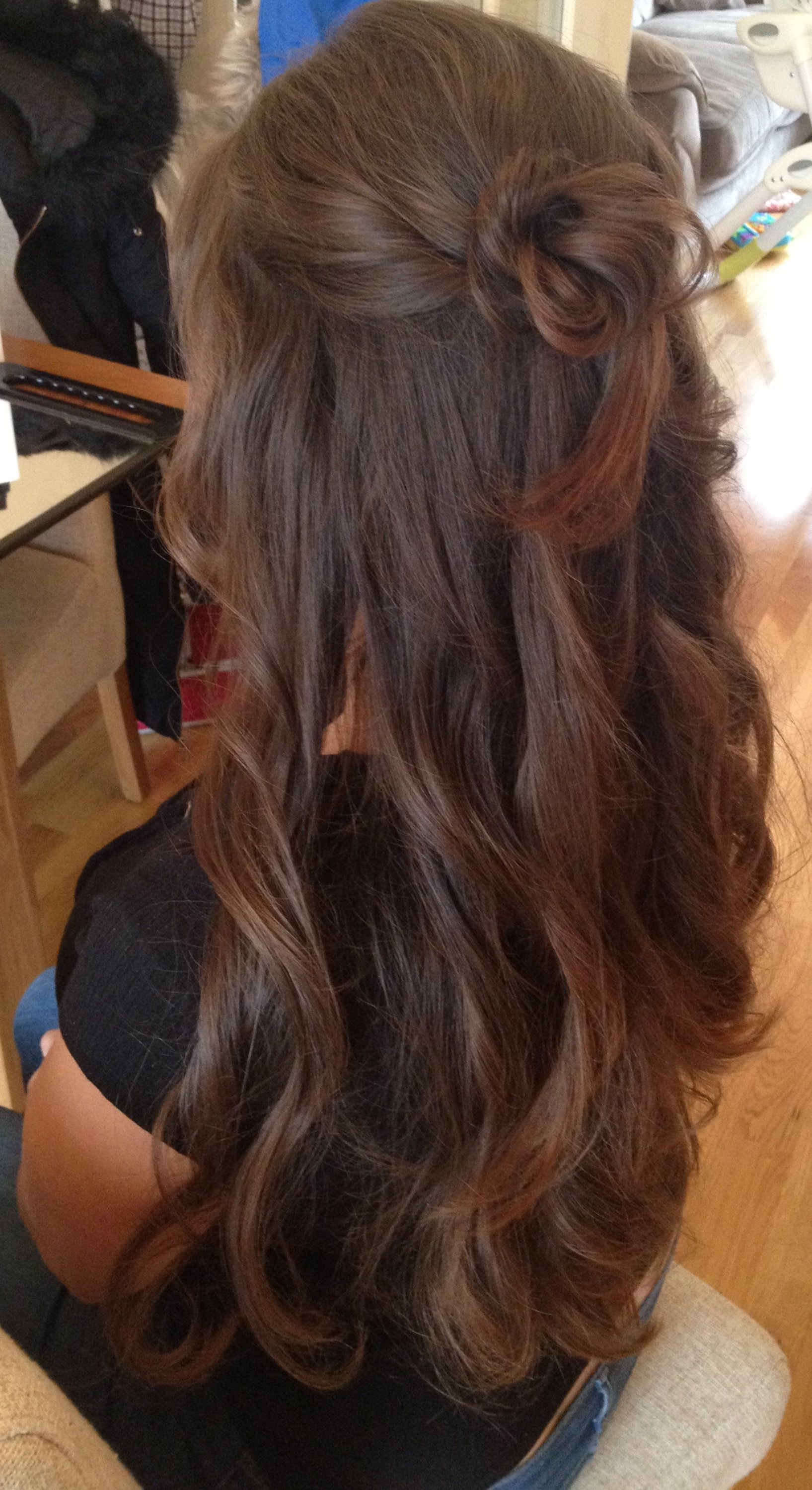 Loose curls with half up twists and messy bun Created by Kirsty at