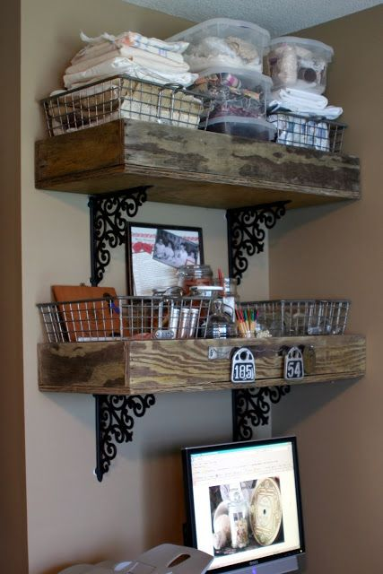 Two large wood boxes supported by iron brackets became shelves for fabric and misc. items.