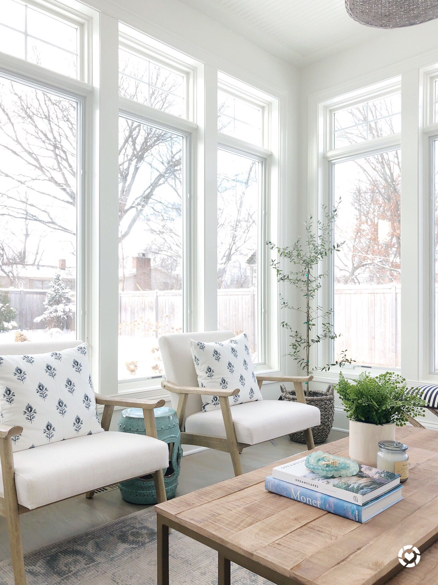Sunroom With Benjamin Moore Simply White Side Chairs Wood Coffee