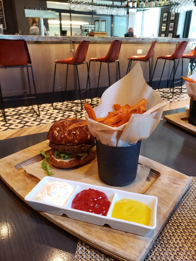 Delicious burger and sweet potato fries served at