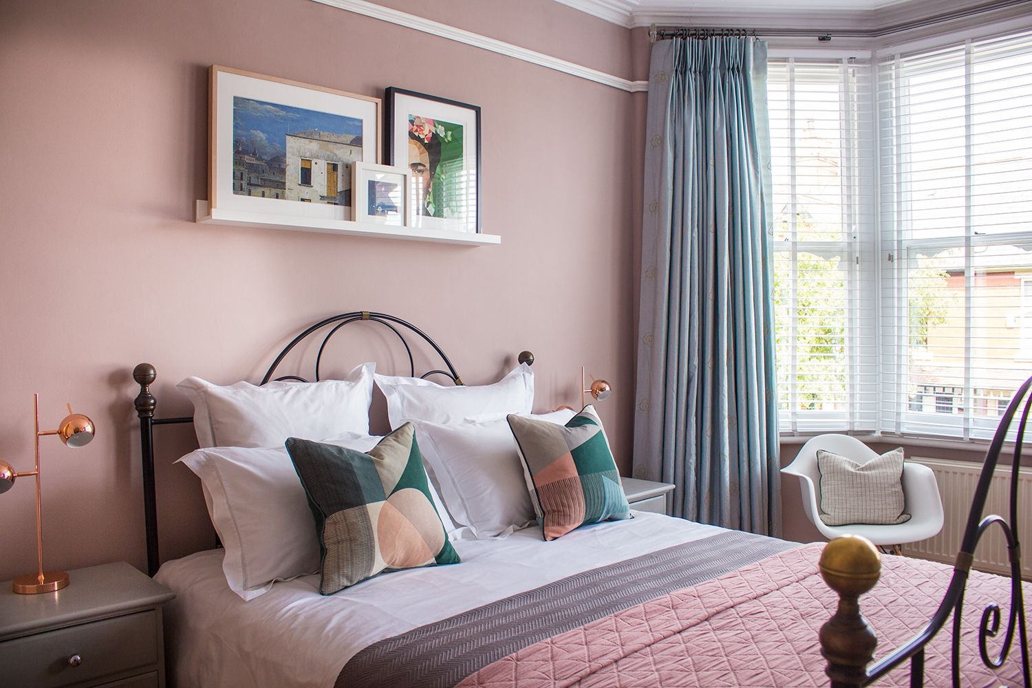 An on trend dusky pink bedroom, styled simply with a ...