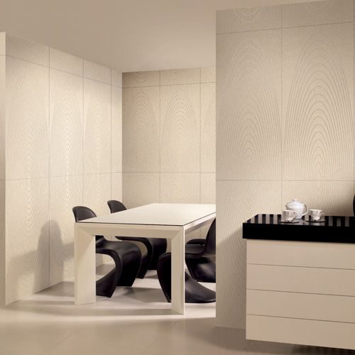 This Secluded Dining Space Features Cream Porcel Thin Paris Large Format Porcelain Wall And Floor