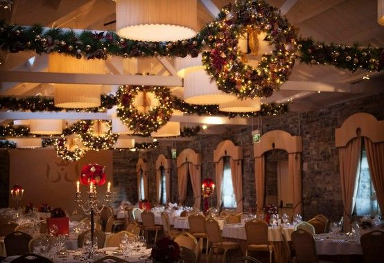 Banquet Hall Dressed For Christmas With Wreaths Candles