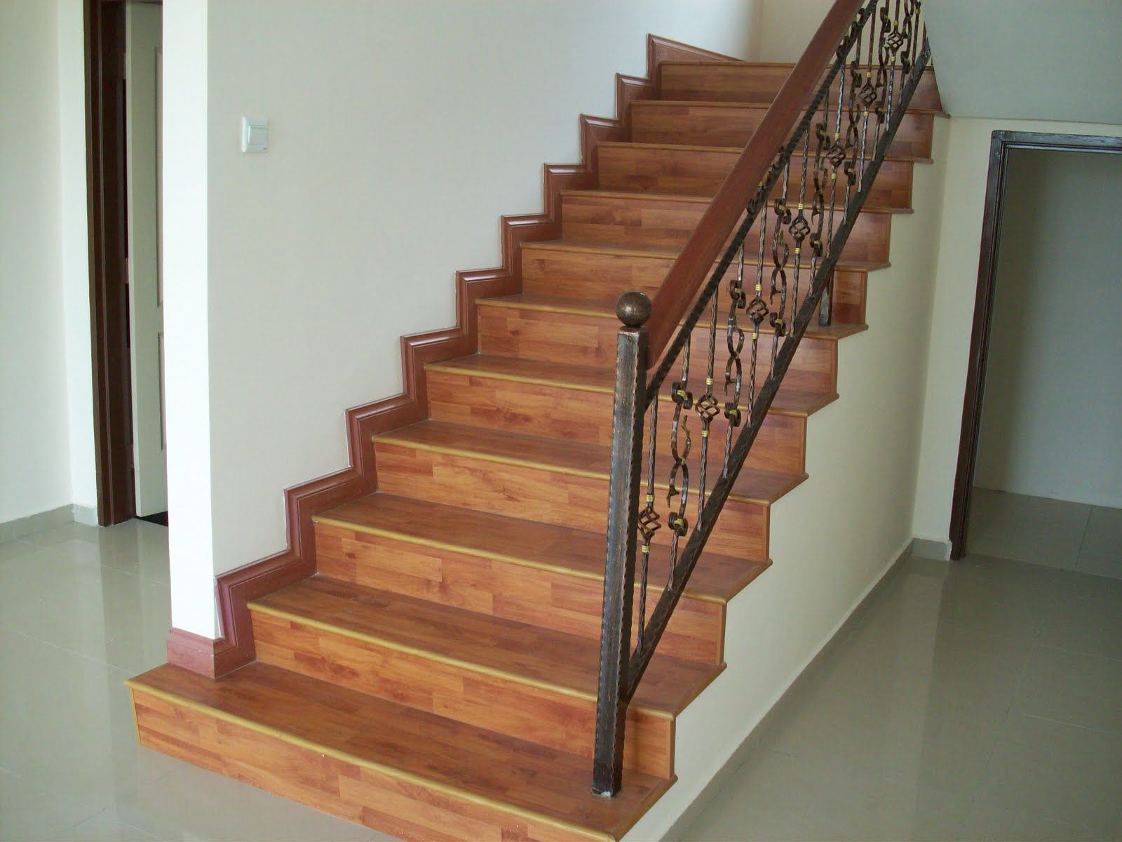 Laminate Flooring For Stairs installing laminate flooring on stairs laminate stair treads stair profile Attractive How To Install Laminate Flooring On Stairs Ideas Created For Indoor Staircase With Hardwood Laminate Flooring And Metal Wood Railingjpg