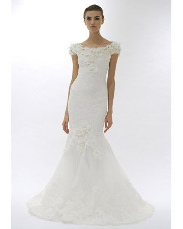 b480419f74b9 Marchesa This off-the-shoulder lace gown has an appliqued tulle skirt with  flower details. marchesa.com