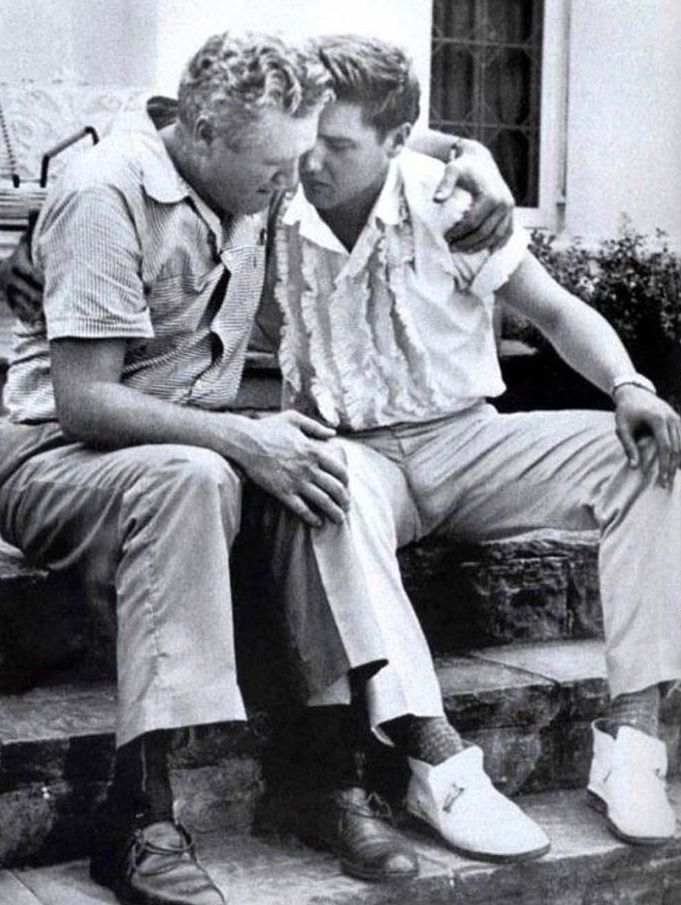 history inpix(1958).Elvis Presley Comforting his father after the death of his mother