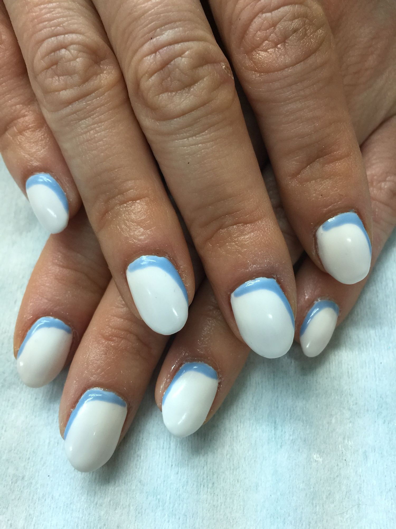 Oval white & curved pale blue accent gel polish over non-toxic ...