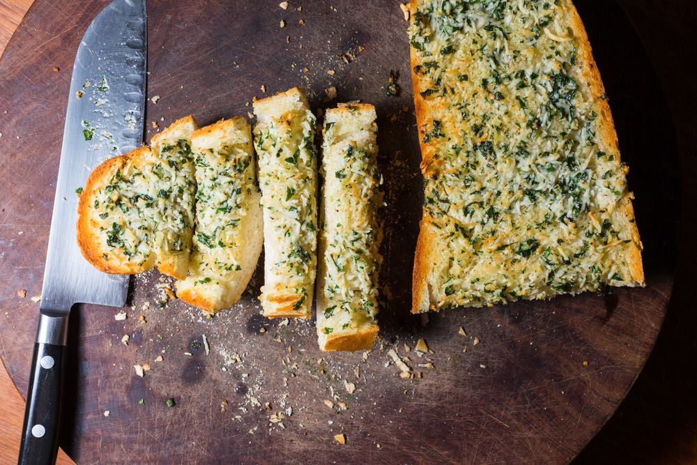 Ingredients     * 1/2 cup butter (1 stick) room temperature     * 1/4 cup Italian Parsley (the flat kind) chopped     * 2 big cloves garlic, crushed     * 1/2 cup parmesan, grated (preferably not the powdered kind)     * 1/2 teaspoon salt     * 1 long French or sour dough loaf, cut ...