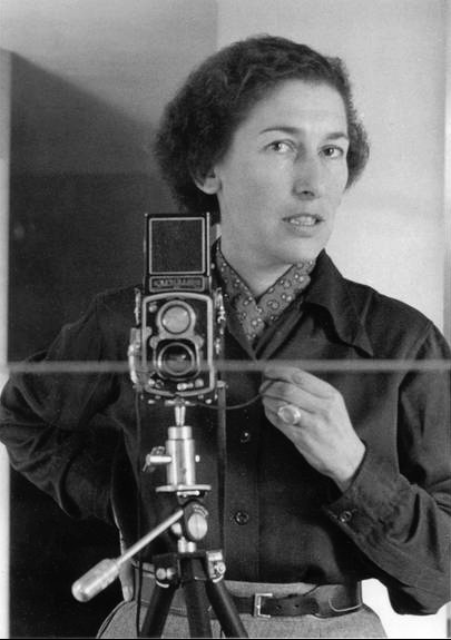 "Gisèle Freund-- Self-portrait-- Undated. ""The lens, that allegedly impartial eye, permits all possible distortions of reality… The importance of photography lies not only in the fact that it is a creation, but above all in the fact that it is one of the most effective means of shaping our ideas and influencing our behavior."""