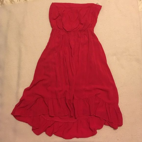 Hi-low red strapless summer dress This is a subtle hi-low super cute, soft and flowy red summer dress. Worn once thus in mint condition empire elastic waist and zipper closure in the back. Dress it up or down! Please let me know if you have any questions.  Forever 21 Dresses High Low
