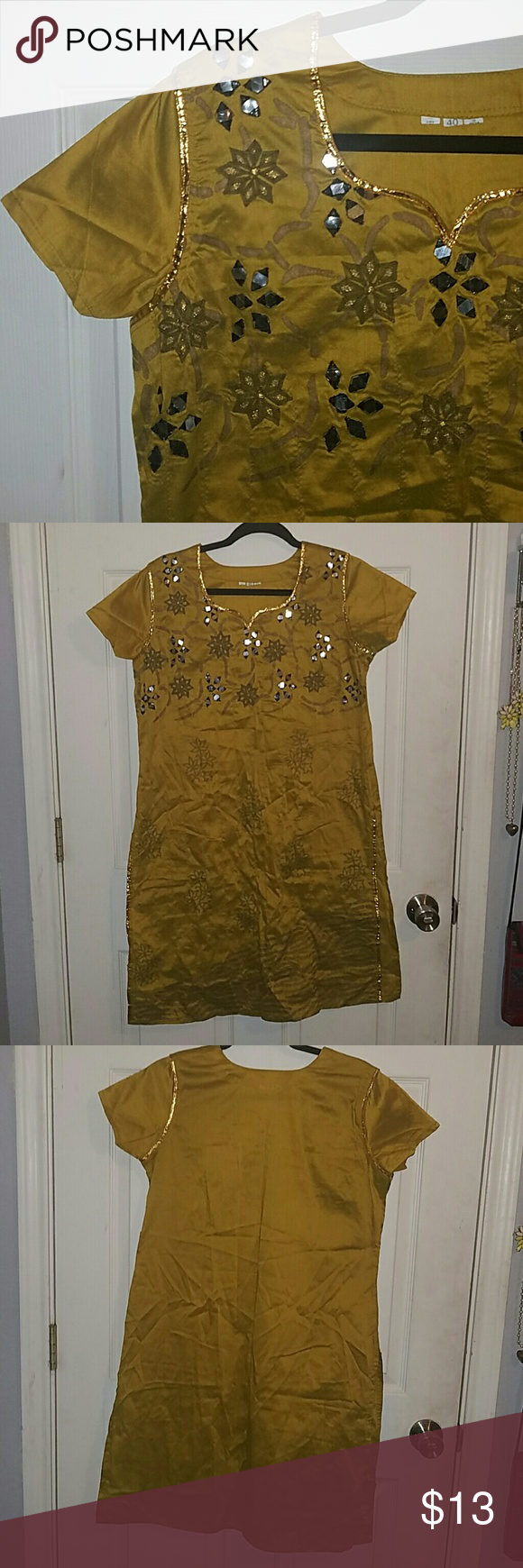 "Kurti Blouse Beautiful Kurti Blouse with sewn openings on sides. Gold/Yellow with embroidered stich design. Nice with some leggings or skinny jeans. Made in India, size 40. Length: 37.5"". Bust: 18.5"". Tops Tunics"