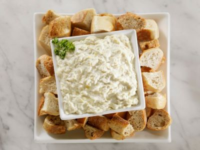 Cheesy Artichoke and Olive Dip -- Add B & G Olives to enhance this tasty recipe - www.bgpickles.com #olives #bgcondiments #appetizer