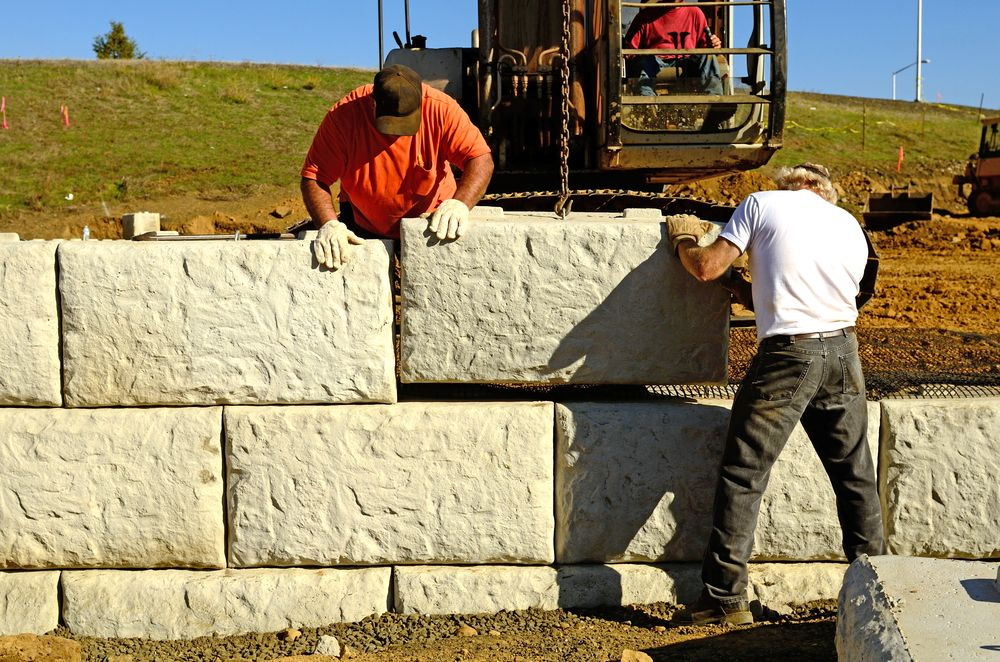 Pin By Adc Hardscapes On Adc Blogs Concrete Retaining Walls Retaining Wall Retaining Wall Construction