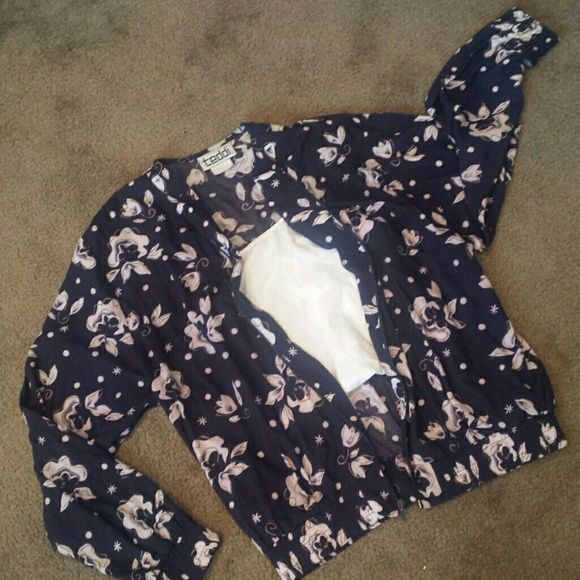 *Vintage* Rayon Floral Bomber Jacket Another vintage find! Cute jacket with pockets. Light weight can be dressed up or down. Bottom and sleeves are elastic. This is in great condition. 75% rayon / 25% polyester. Navy blue with faint pink-white flowers. The last two photos Jackets & Coats