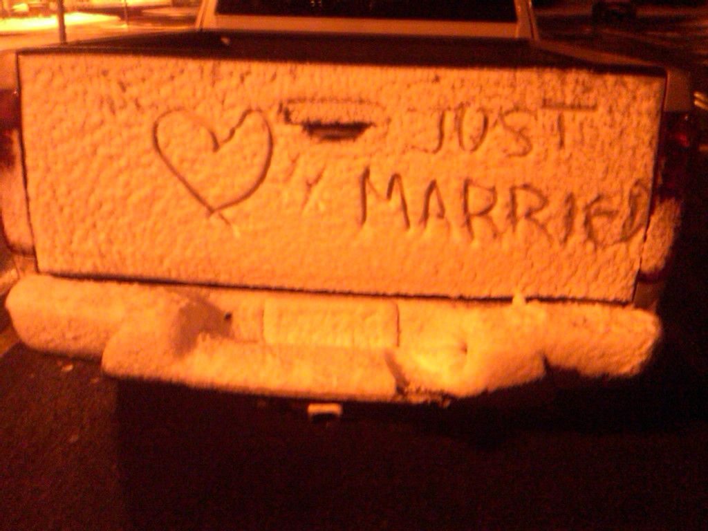 Just Married on a pickup truck in snow