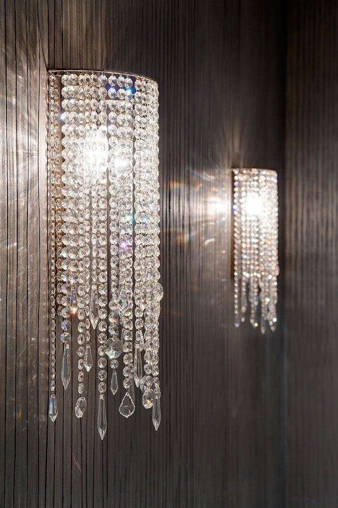 feature wall lighting. Decorative And Blingy Feature Wall Lights Which Set Off The Dark Metallic Wallpaper © Hill House Interiors Lighting