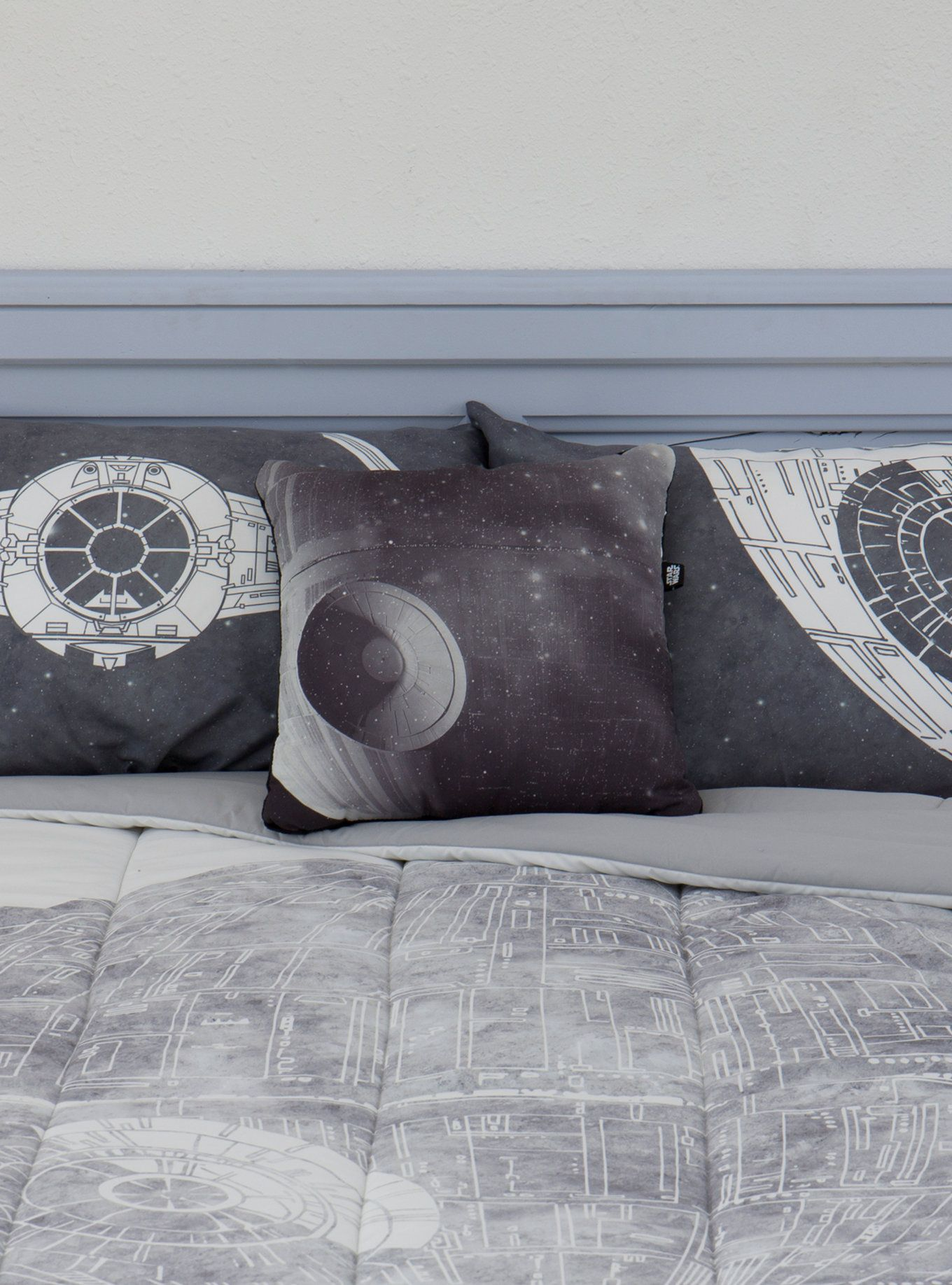 """That's no moon, that's a pillow! And a cozy one at that! This decorative pillow from  Star Wars  has a black and white image of the Death Star on front and a super soft black plush material on back.    Polyester  15"""" x 15""""  Imported"""
